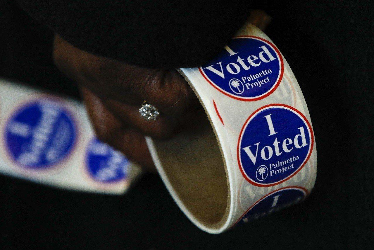 距離大選一個月,絕大多數選民都已經決定要投票給誰,仍在猶豫的只有6%。(美聯社)